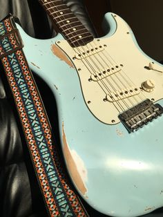 TRS. 1962 Fender Sonic Blue Strat. Stratocaster. Vintage. Guitar strap.