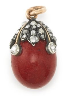 A Fabergé jeweled gold-mounted purpurine Easter egg pendant, workmaster August Hollming, St. Petersburg, 1898-1903, with a diamond-set foliate mount.