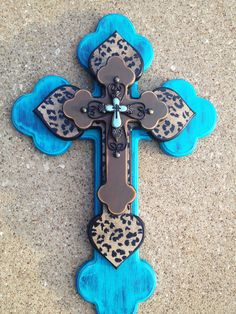 Turquoise stacked wooden cross  Stacked cross that I made.   I'm in a FB Best Cross contest that ends on 11/21/12.  Would love your vote.   I have 4 crosses on the site.   Go to http://www.facebook.com/woodcraftpatterns  All you have to do is like one of my pictures.  They say created by Kirk Johnson and were posted on Thursday 11/15/12.