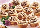 Pecan Tassies Ingredients Tart Shells 1/2 cup butter or margarine, softened 3 oz cream cheese, softened 1 cup all-purpose flour Filling 2 tbsp butter or margarine, melted 3/4 cup packed brown sugar 1 egg 1 teaspoons vanilla 1 cup pecan halves, finely chopped Powdered sugar (optional)