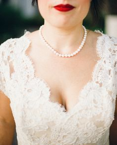 Bold lips, lace,  pearls.   Photography: The Hearts Haven - www.theheartshaven.com  Read More: http://www.stylemepretty.com/california-weddings/2014/06/20/sweet-elopement-at-mural-room-of-the-santa-barbara-courthouse/