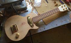 Les Paul electric ukulele being built.