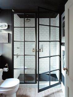 The New Normal Jenny Wolf Interiors Blackened steel window frames are having a massive moment. Put to use as shower doors and paired with a combination of white subway and black penny tile, Wolf pulls off an elevated steampunk aesthetic. *golf clap* lonny.com