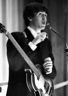Paul McCartney with his Hofner bass, 1963.