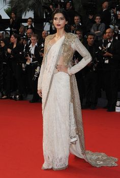 Attending her third year at the Cannes film festival, Sonam Kapoor mixed it up once more. She shunned a gown for a white lace saree, worn. Sonam Kapoor Saree, Sonam Kapoor Cannes, Anamika Khanna, Saree Draping Styles, Saree Styles, Dress Styles, Saris, Indian Dresses, Indian Outfits