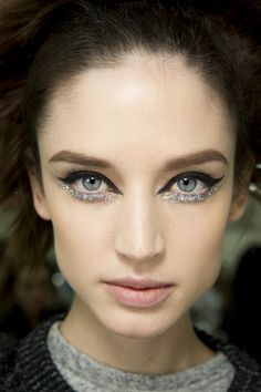 Chanel...cat eye, glitter on the lower lids