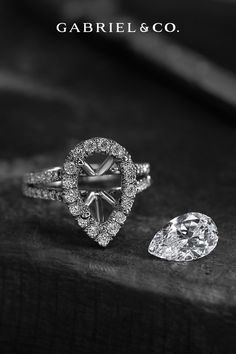 This Beautiful Pear-Shaped Diamond Combines Edginess & Sensuous Curves.... so Diamonds or You're New Best Friend. Choose Your Gem! #WhiteGoldEngagementRing #WhiteGoldRing #PearshapedEngagementRing #PearshapedRing #DiamondEngagementRing #UniqueEngagementRing #ElegantEngagementRing #ClassicEngagementRing #GabrielNY#UniqueJewelry #FineJewelry#GabrielAndCo #BridalRing #BeautifulEngagementRing #DiamondRing #UniqueDiamondRing #ClassicRing Best Engagement Ring Designers, Elegant Engagement Rings, Pear Shaped Engagement Rings, Diamond Engagement Rings, Unique Diamond Rings, Pear Shaped Diamond, Bridal Rings, Jewelry Branding, White Gold Rings