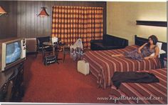 """Motel room with girl in bed. """"Now with Color TV, Air Conditioning, Heated Pool, Large Family Rooms, Kitchenettes and Telephones."""" Love the curtains!"""