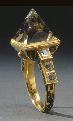Courtesy of The Royal Armoury (http://emuseumplus.lsh.se/eMuseumPlus). The gold ring designed for the coronation of Charles IX (Karl IX) of Sweden, decorated with black enamel and six small rock crystals. The large pointed stone is smokey quartz.