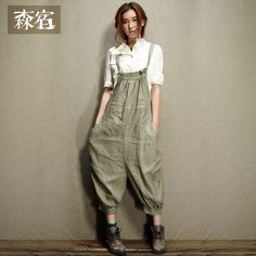 1940's Newsboy-Inspired Linen Overalls with exaggerated, suspender-style back.  Slight bib in front; adjustable straps that tie to bib in front. Side pockets. MEDIUM: Linen (Flax) /  Label: Sam's Tree / Mori places... Spring 2013 Collection