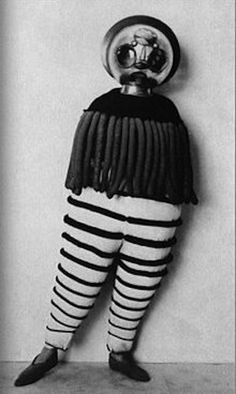 Anyone want to come as this...thing?  Bauhaus costume party, 1920s