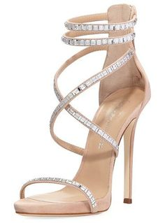 "Coline Suede and Crystal Sandal by Giuseppe Zanotti for Jennifer Lopez. Giuseppe Zanotti for Jennifer Lopez suede sandal with crystal embellishments. 4.3"" covered stiletto heel with platform. Thin strap bands open toe. Crisscross strappy vamp. d'Orsay silhouette. Back zip eases dress. Leather lining and sole... #giuseppezanottiforjenniferlopez #nudeshoes #sandals"