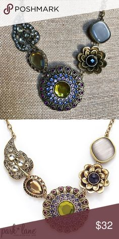"""Park Lane Casablanca Necklace Great condition and stored in smoke free home. Never worn. SOLD OUT & lovely """"CASABLANCA"""" NECKLACE.  Park Lane used Amethyst, Pink & Lavender Swarovski Crystals set in Antiqued gold plating to fashion the ornately jeweled centerpiece to this stunning necklace.  Various shapes & sizes including cat's eye and cabachon gems add to the appeal of this beautiful necklace. The necklace measures 18"""" long with a 3"""" extension. See the matching bracelet listed separately…"""