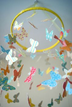 Season With Love: DIY Butterfly Mobile I like how she ran fishing line through the butterflies and superglued them in place.  It makes the butterflies look like they are really fluttering;-)