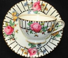 ANTIQUE-AYNSLEY-PINK-ROSES-YELLOW-BLUE-BLACK-STRIPES-TEA-CUP-AND-SAUCER