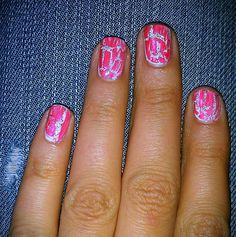 White nail polish, pink crackel, and some glitter nailpolish.