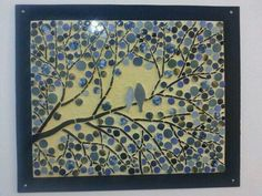 A pair of mosaic birds on a tree branch , by Iris Bello