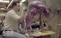 Trevor L. Hensley adds paint detail to the Stan Winston Studio animatronic, tentacled alien puppet.