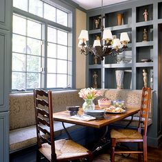 Banquette with Cubbies  Banquettes offer a bold complement to walls of beautiful millwork. This banquette, which makes use of an existing kitchen table, was designed in tandem with display cubbies above for a dining room look. Fabric on the cushions tie in the wall trim and paint.