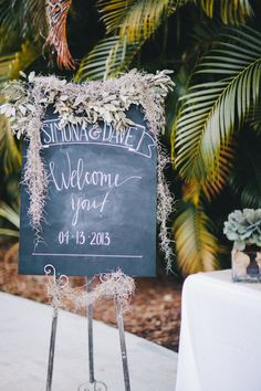 Pretty welcome signage | DIY Backyard Wedding in Jupiter from Michelle Kristine  Read more - http://www.stylemepretty.com/florida-weddings/2013/09/20/diy-backyard-wedding-in-jupiter-from-michelle-kristine/