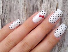 White and black poke-a-dot nail design