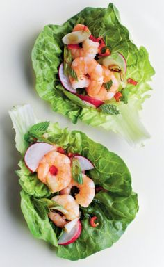 These assemble-at-work lettuce leaf wraps from The Little Book of Lunch are perfect for eating on the grass on a sunny summer day. The recipe is delightfully versatile: leftover scraps of chicken, beef or prawns all work well with a firm, crunchy lettuce leaf. Simple, quick, delicious.