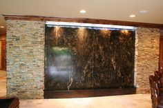 This is my waterfall wall concept except the whole wall is volga blue granite.
