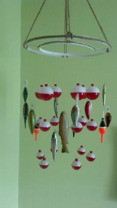 Bobber and fish mobile. Baby boy fish themed nursery. (no link-just picture) Embroidery hoops spray painted white with jute twine hot-glued on. Bobbers hang from middle hoop and fishing lures hang on the outside hoop.