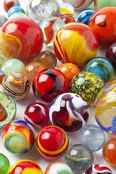 Glass Marbles / Boys played a slightly different game than the girls.  We both played Keepsies.  Large ones are called shooters.
