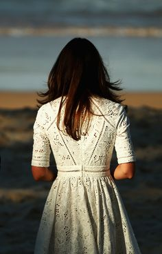 I never get tired of looking at pictures of her.  And I love this eyelet dress.