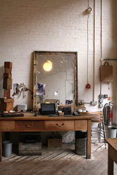 Wonderfully inviting deconstructed studio/ work space with such gorgeous, soft light...
