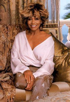 Tina Turner, I love  this photo of her. She manages to look both cozy and elegant.