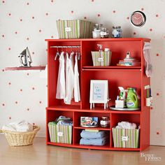 Transform an old entertainment center into a laundry center, organize laundry and other cleaning supplies
