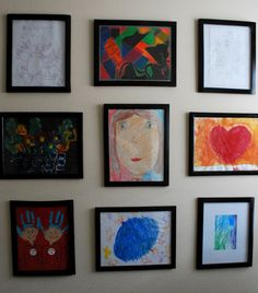 Rotating kids' art gallery wall-- purchased a number of 8x10 wood frames  from the dollar store & spray-painted the frames black to give the wall a uniform feel. Hang the frames on the wall in a grid pattern.
