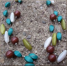 uniquely handcrafted necklace in green, olive, white, and brown. - LOVE!  $30