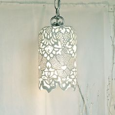 Carved White Porcelain Pendant Lamp from 'Isabelle Abramson Ceramics' can be made onto an upturned coke bottle.cut outs in this design and made into a lamp.