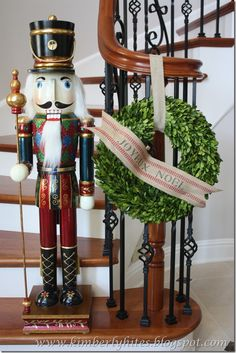 boxwood wreath with banner & life-size nutcracker.