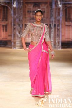 Ileana D'Cruz was a stunner in a neon-pink sari teamed with silver-toned blouse at the India Couture Week 2014 finale. Choli Designs, Saree Blouse Designs, Bollywood Dress, Bollywood Fashion, Saree Fashion, Bollywood Actors, India Fashion, Asian Fashion, Fashion Beauty