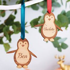 Personalised Wooden Penguin Decoration. A cute and quirky engraved wooden penguin decoration, personalise with a name and choose from 7 festive ribbon colours.
