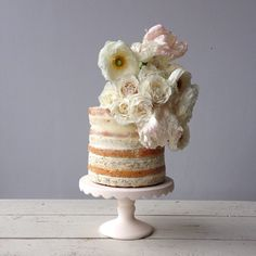 Naked wedding cake with cream flowers by Knead to Make