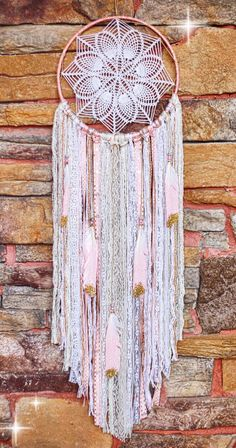 A personal favorite from my Etsy shop https://www.etsy.com/listing/248900011/bohemian-doily-dreamcatcher-10-hoop