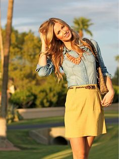 denim shirt, mustard skirt, brown belt and brown shoes @Nicki Bradford Kana. Simple outfit with statement necklace.