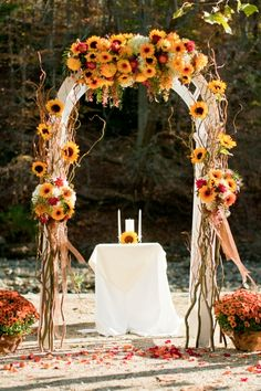 Fall Wedding Arch, I like the small table for a unity or sand ceremony....