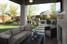 An outdoor TV and fireplace make your patio the perfect place to watch a late-night movie. Seen in Trinity Falls, a Dallas community.