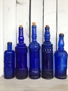 Vintage cobalt blue glass bottles blue supply bottles by MellaFina. $89.00, via Etsy.