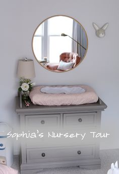 changing table, simple and sweet with round mirror and bunny decor.