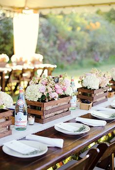 Brides.com: 13 Creative Ideas for a Winery Wedding. For table decor, fill wine crates with flowers.  See more wedding centerpiece ideas.