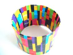 Recycled Eco Jewelry- Water Bottle Bangle. Could use recycled sticky vinyl scraps or decoupage magazine paper
