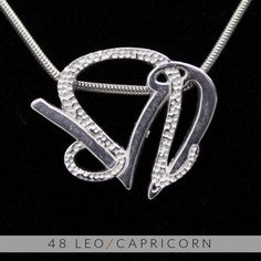 The Leo and Capricorn Silver Unity Pendant from UNITY DESIGN CONCEPTS
