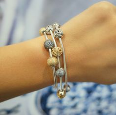 PANDORA Essence silver and 14k gold charms mixed. #PANDORAEssence #PANDORAbracelets #PANDORAcharms